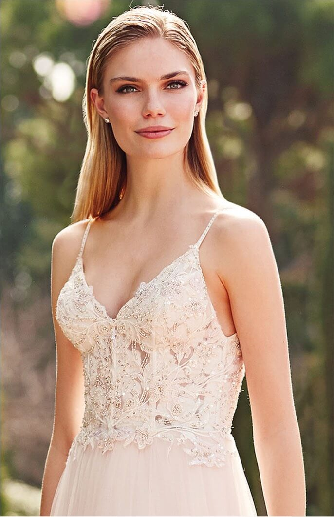 Model wearing a thin straps style gown